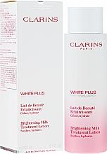 Parfumuri și produse cosmetice Lapte pentru față - Clarins White Plus Brightening Milk Treatment Lotion
