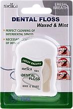 Parfumuri și produse cosmetice Ață dentară cu aromă de mentă - Melica Organic Dental Floss Waxed & Mint