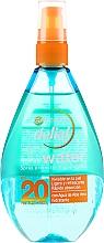 Parfumuri și produse cosmetice Spray cu protecție solară pentru față și corp - Garnier Delial Ambre Solaire UV Water Transparent Protecting Spray SPF20