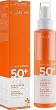 Parfumuri și produse cosmetice Spray de protecție solară pentru corp - Clarins Lait-en-Spray Solaire Corps 50+