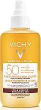 Parfumuri și produse cosmetice Spray bifazic de protecție solară cu beta-caroten, pentru bronzare, pentru față și corp, SPF50 - Vichy Capital Soleil Solar Protective Water