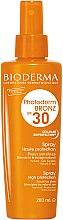 Parfumuri și produse cosmetice Spray cu protecție solară pentru piele sensibilă - Bioderma Photoderm Bronz SPF30 Protection Spray