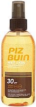 Parfumuri și produse cosmetice Spray de protecție solară pentru corp - Piz Buin Wet Skin Transparent Sun Spray SPF30