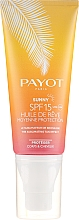 Parfumuri și produse cosmetice Ulei uscat de proteție solară pentru corp și păr - Payot Sunny The Sublimating Tan Effect Body and Hair SPF15