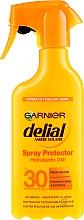 Parfumuri și produse cosmetice Spray hidratant cu protecție solară - Garnier Delial Ambre Solaire 24h Hydration Spray Protector SPF30