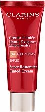 Parfumuri și produse cosmetice Cremă revitalizantă cu efect tonifiant - Clarins Super Restorative Tinted Cream SPF 20