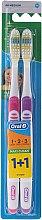 Parfumuri și produse cosmetice Set de periuțe de dinți (medium, violet + roz) - Oral-B 1 2 3 Maxi Clean 40 Medium 1+1