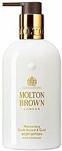 Parfumuri și produse cosmetice Molton Brown Mesmerising Oudh Accord & Gold - Loțiune pentru mâini